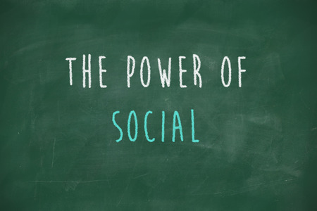 Power of social handwritten on school blackboard photo