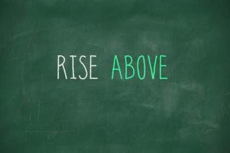 rise above: Rise above handwritten on school blackboard Stock Photo