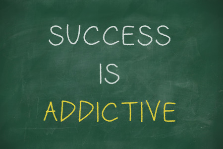 addictive: Success is addictive handwritten on school blackboard
