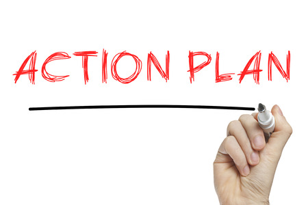 Hand writing action plan on a white board Standard-Bild