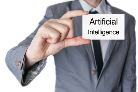 Artificial intelligence. Businessman in suit with a black tie showing or holding business card  photo