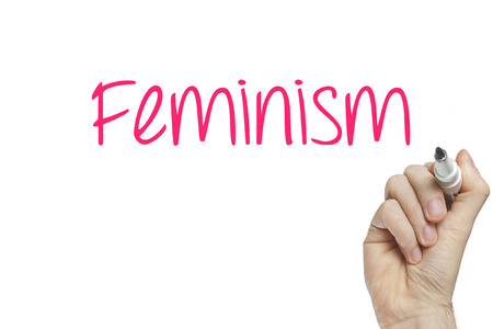 Hand writing feminism on a white board photo