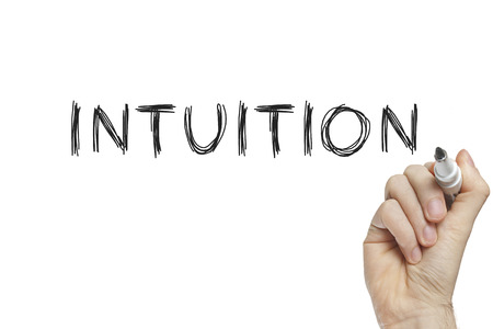 intuition: Hand writing intuition on a white board