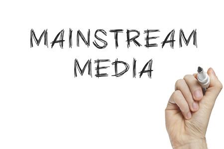mainstream: Hand writing mainstream media on a white board Stock Photo