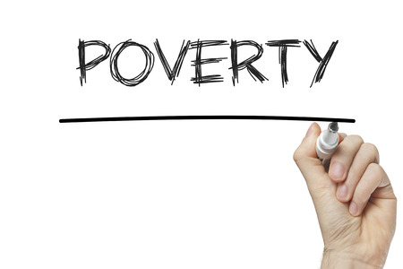 Hand writing poverty on a white board photo