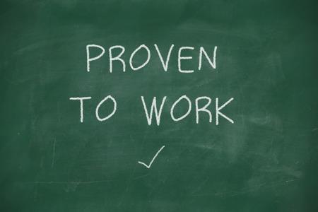 proven: Proven to work handwritten on school blackboard Stock Photo