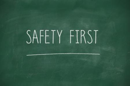 safety first: Safety first handwritten on school blackboard Stock Photo