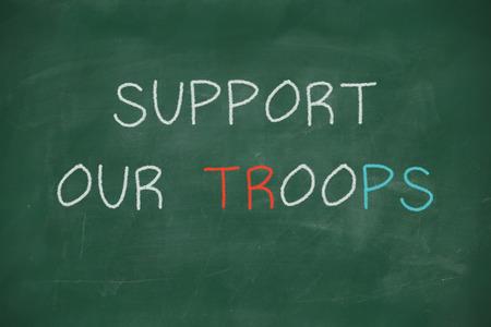 troops: Support our troops handwritten on school blackboard