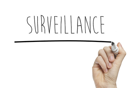 monitored: Hand writing surveillance on a white board