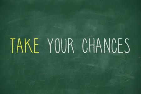 Take your chances handwritten on school blackboard photo