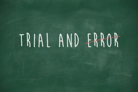 Trial and error handwritten on school blackboard photo