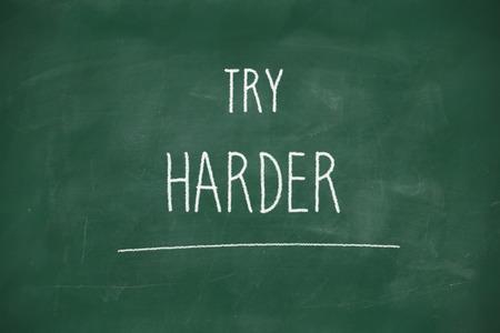Try harder handwritten on school blackboard photo