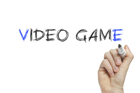 Hand writing video game on a white board photo