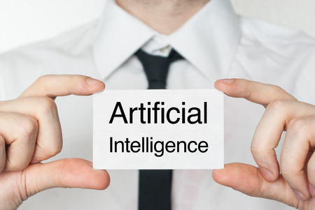Artificial intelligence. Businessman in white shirt with a black tie showing or holding business card  photo