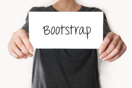 bootstrap: Bootstrap. Female in black shirt showing or holding a card Stock Photo