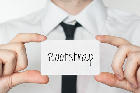 bootstrap: Bootstrap. Businessman in white shirt with a black tie showing or holding business card
