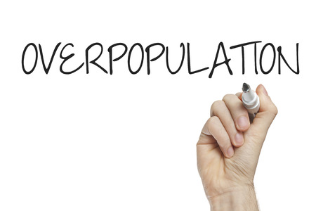 overpopulation: Hand writing overpopulation on a white board Stock Photo