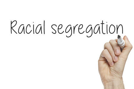 Hand writing racial segregation on a white board photo