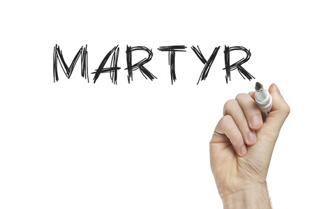 martyr: Hand writing martyr on a white board