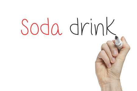 Hand writing soda drink on a white board photo