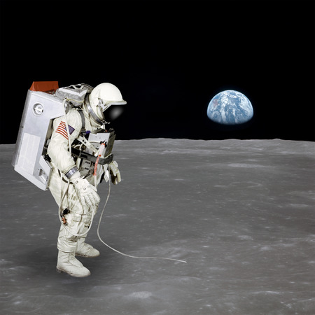 High quality isolated composite astronaut walking on moon.  photo