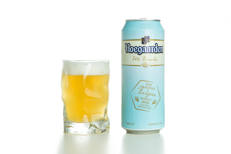 unfiltered: TOURS, FRANCE - September 28,2014: Hoegaarden is a witbier and is spiced with coriander and orange peel. It is unfiltered and therefore has a cloudy appearance.