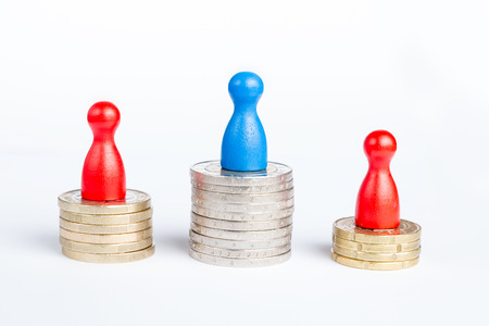 Game figurines on top symbolizing first place champion and financial success, on white photo