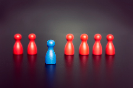 Stand out and be unique - leadership business concept with game figurines