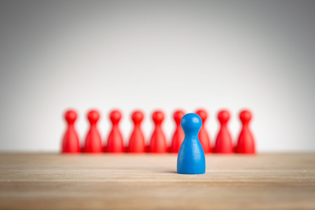 standing in line: Stand out and be unique - leadership business concept