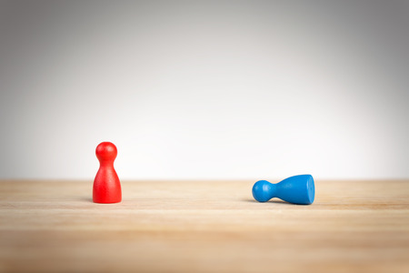 Business defeat or bowing to the king concept with game pieces on white Stock Photo