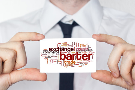 barter: Barter. Businessman in white shirt with a black tie showing or holding business card Stock Photo