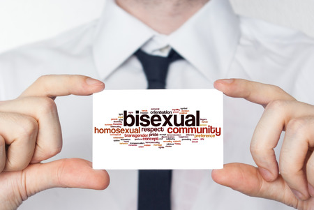 bisexual: Bisexual. Businessman in white shirt with a black tie showing or holding business card