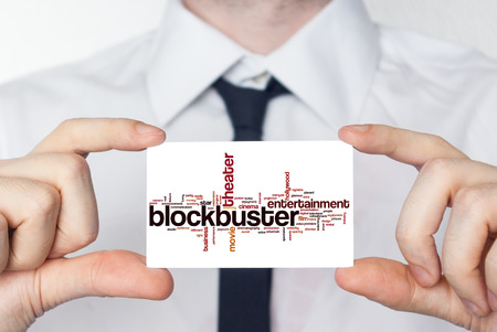 blockbuster: Blockbuster. Businessman in white shirt with a black tie showing or holding business card Stock Photo