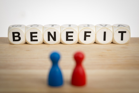 financial reward: Benefit concept: Two pawns in front of toy dice Stock Photo