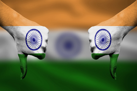 failure of India - hands gesturing thumbs down in front of flag photo