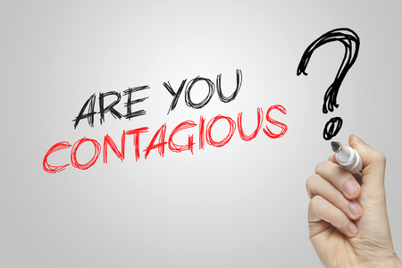 contagious: Hand writing are you contagious on grey background