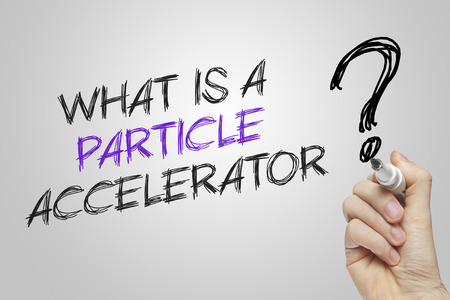 accelerator: Hand writing what is a particle accelerator on grey background