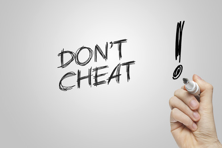 cheat: Hand writing dont cheat on grey background