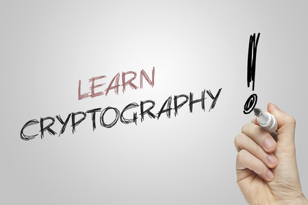 cryptography: Hand writing learn cryptography on grey background