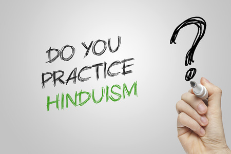 hinduism: Hand writing do you practice hinduism on grey background