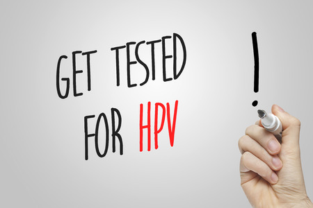 Hand writing get tested for HPV on grey background