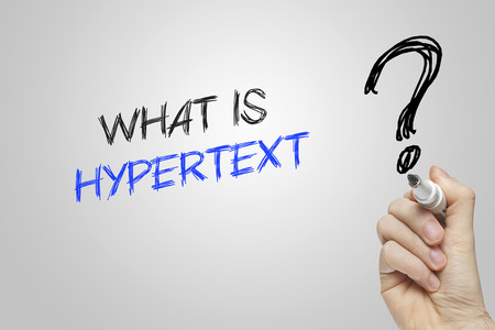 hypertext: Hand writing what is hypertext on grey background