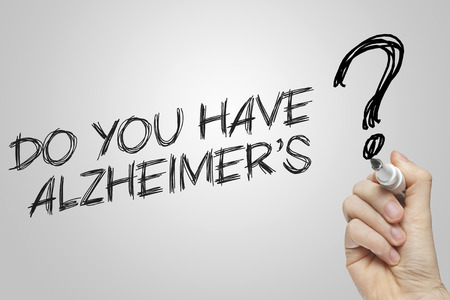 alzheimers: Hand writing do you have alzheimers on grey background