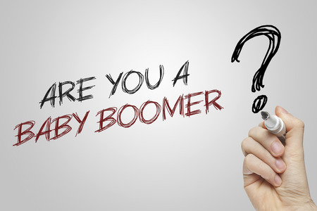 Hand writing are you a baby boomer on grey background Stock Photo