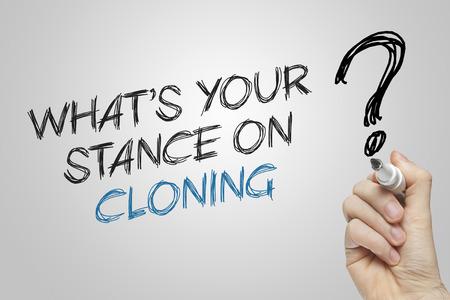 clonacion: Escritura de la mano cu�l es su postura sobre la clonaci�n sobre fondo gris