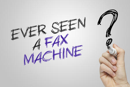 fax machine: Hand writing ever seen a fax machine on grey background