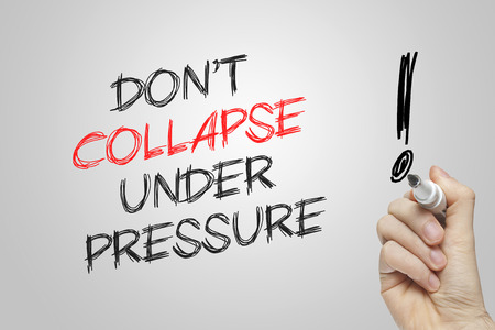 under pressure: Hand writing dont collapse under pressure on grey background Stock Photo