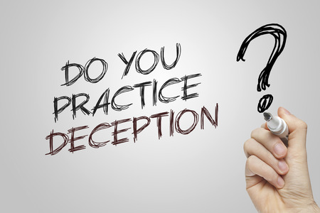 deception: Hand writing do you practice deception on grey background