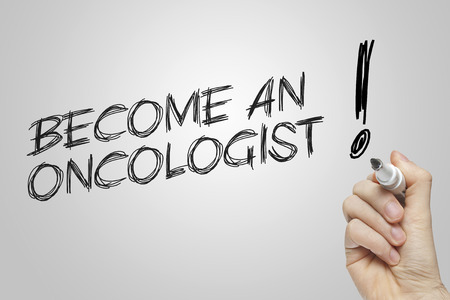 oncologist: Hand writing become an oncologist on grey background