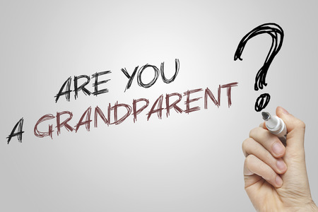 grandparent: Hand writing are you a grandparent on grey background